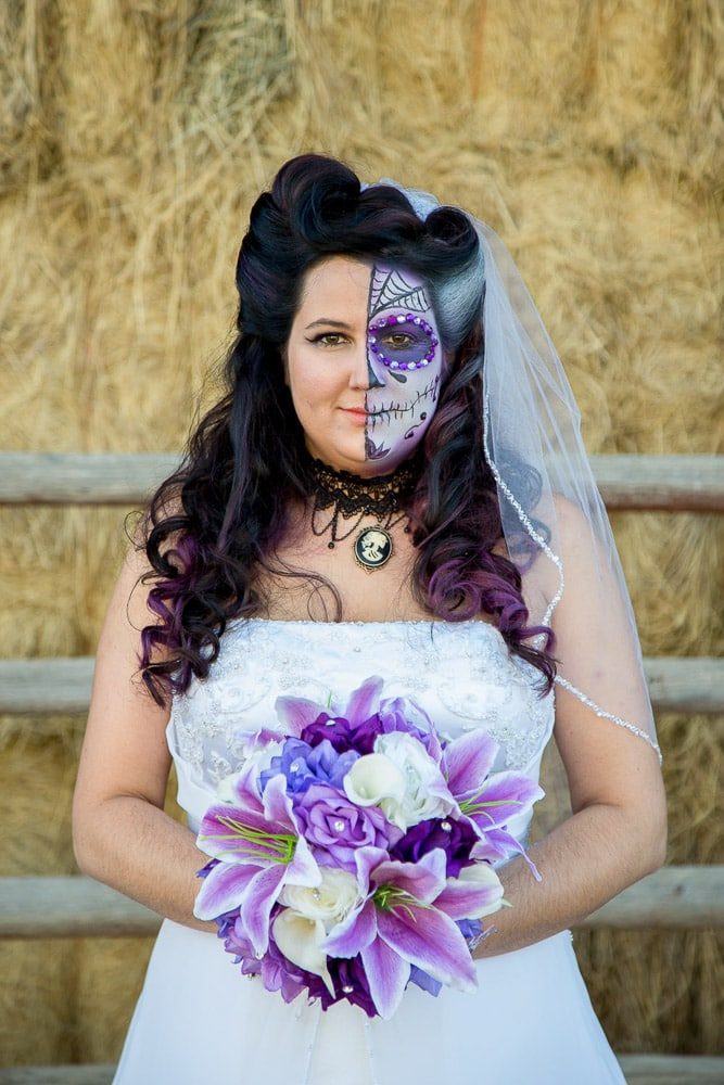 A bride in Halloween face paint at her McC Ranch wedding.