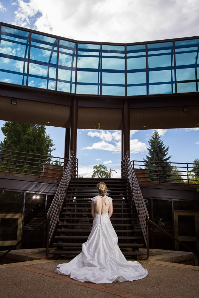 A modern Colorado bride in her dress before her wedding at Foote Lagoon in Loveland.