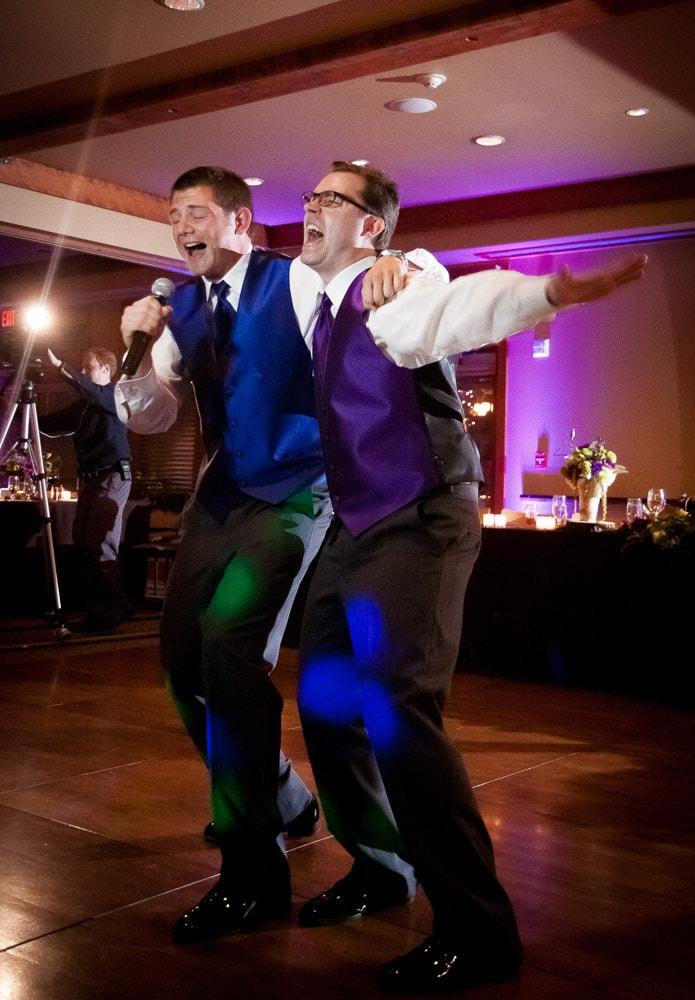 Groomsmen singing on the dancefloor at fun Fort Collins wedding.