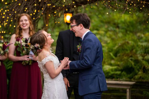 Exchanging rings at Camrose Hill by Minneapolis wedding photographer