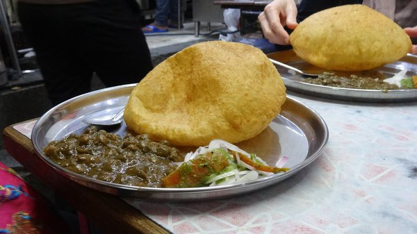 chole bature (fried, puffed bread paired with chickpea curry)