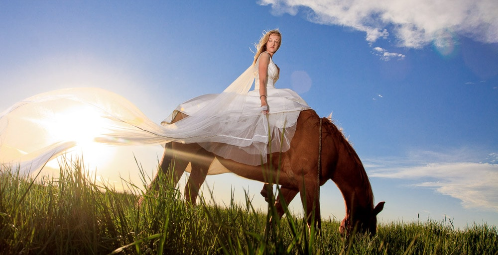 A bride riding her horse at sunset after her Fort Collins wedding.