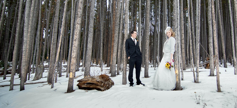 A bride and groom in the aspen trees and snow at their Breckenridge Resort wedding.