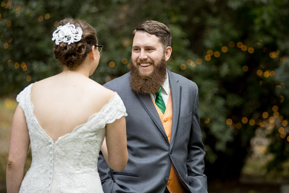 A groom sees his bride for the time at the first look before their Tapestry House wedding.