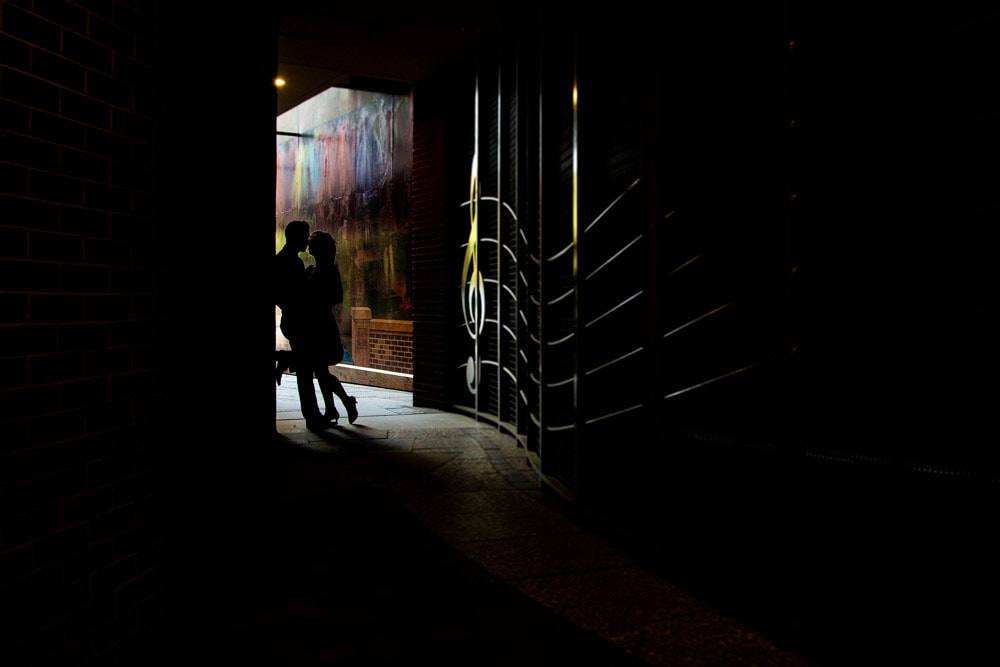 A silhouette of a couple in an alleyway during their old town Fort Collins engagement photo session.