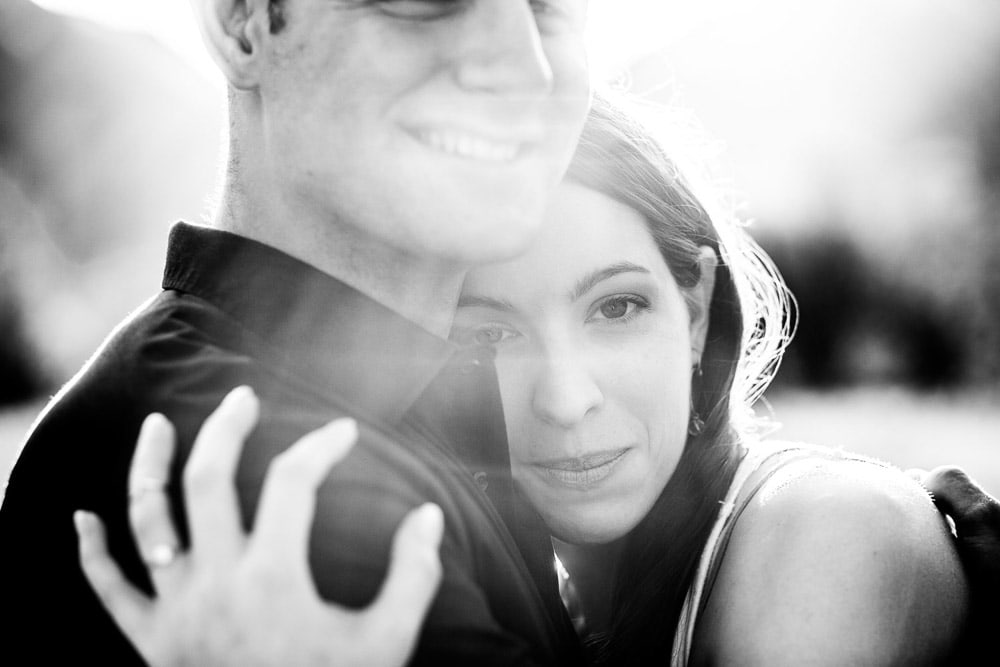 Black and white close up photo of a couple during their engagement photo session in the mountains near Estes Park, Colorado.