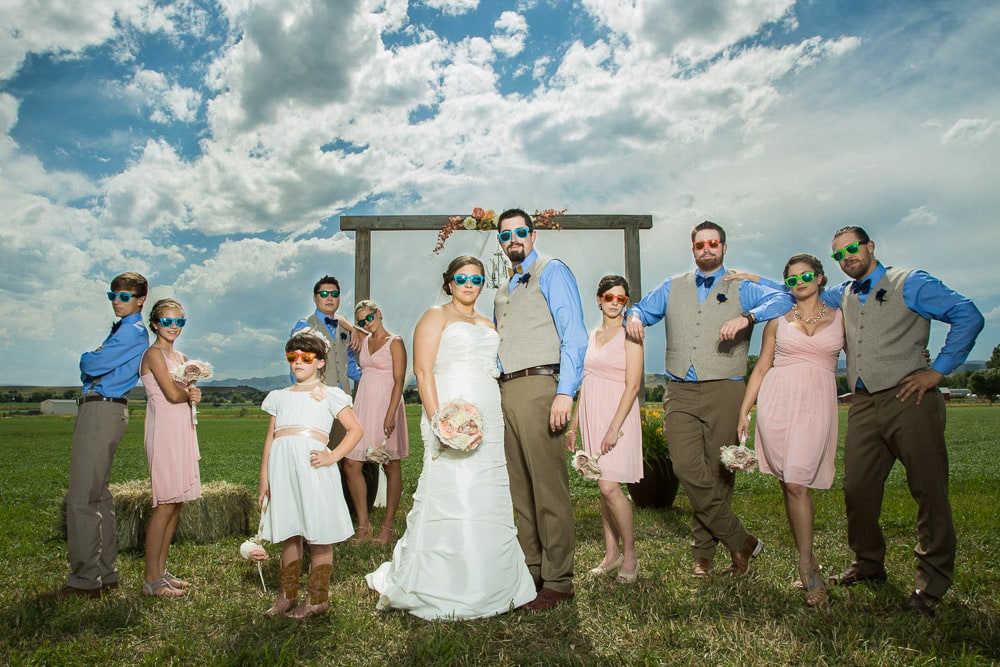 A wedding party pose in sunglasses after a DIY farm wedding in Longmont, Colorado.