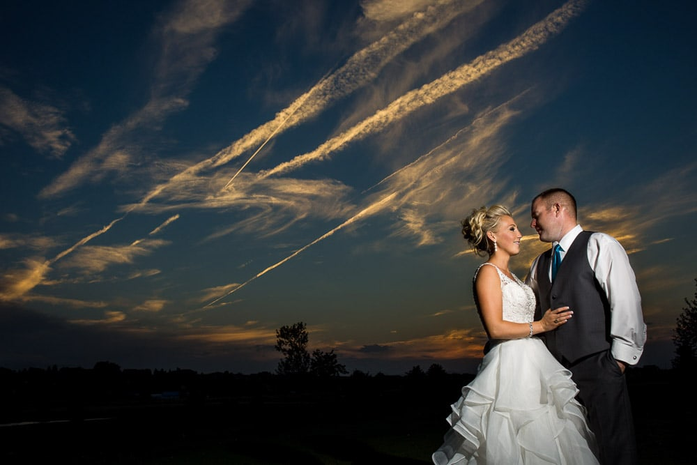 A bride and groom at sunset on the island at their Pelican Lakes Golf Course wedding.
