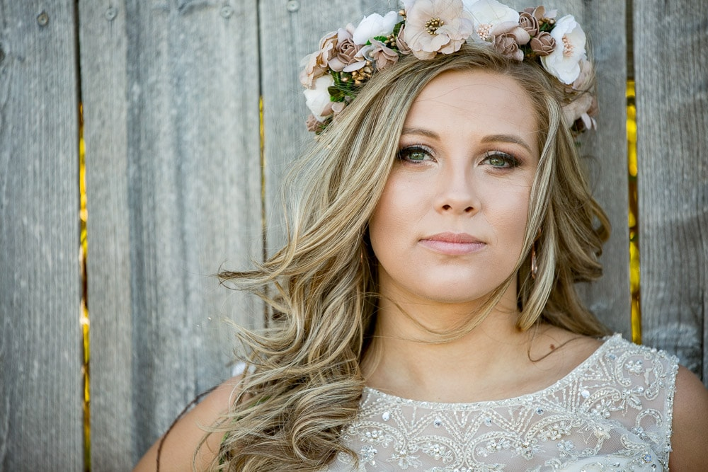 A bohemian bride with a floral crown on her wedding day at the Greeley Country Club.