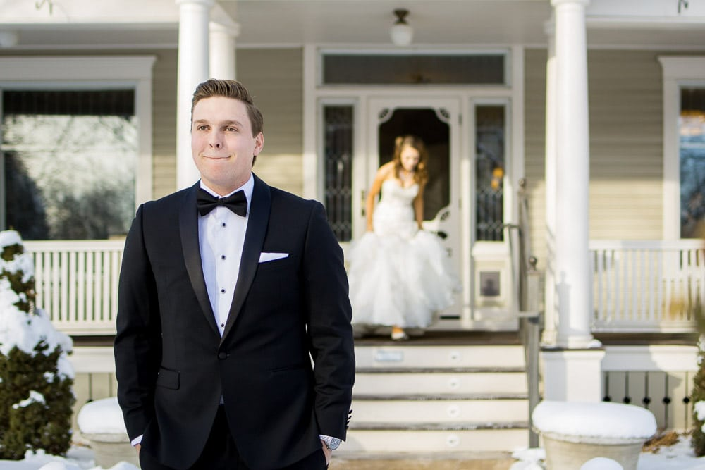 A groom waits excitedly for his bride during the first look at their Fort Collins winter wedding.