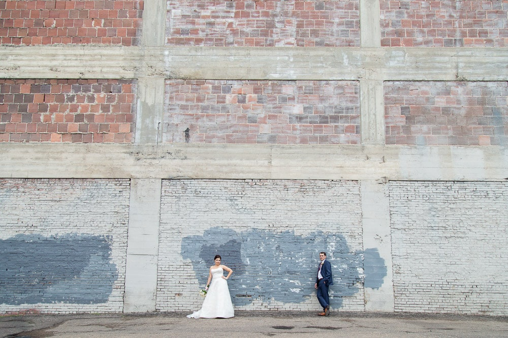 A modern bride and groom in downtown denver at their Grand Hyatt wedding.