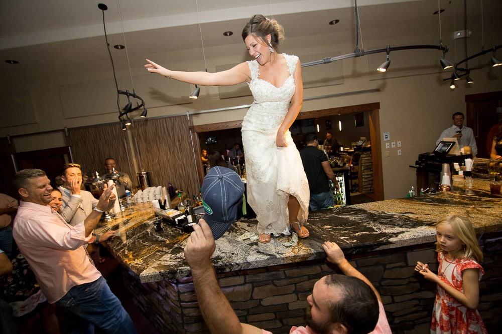 A bride dancing on the bar at her Longmeadow Event Center wedding.