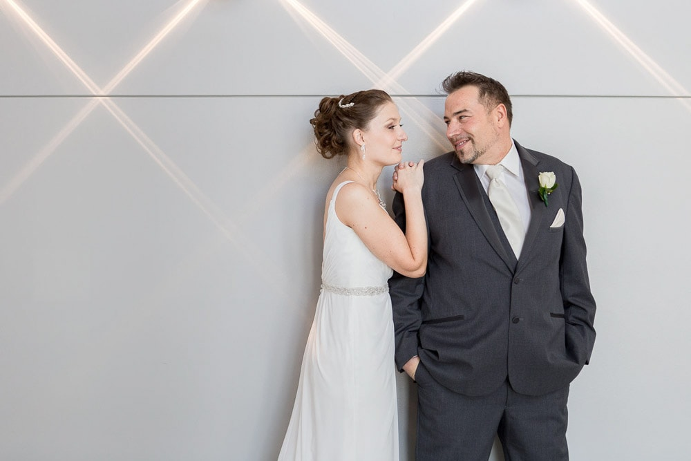 A modern bride and groom smile at eachother before their Windsong Estate wedding in Fort Collins.