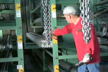 An operator retrieves steel angle bundle from Rack Receptacle in under five minutes.