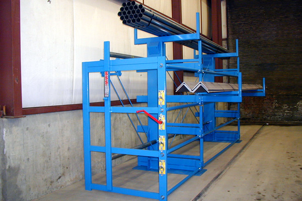Front side-view of a One-Sided, Right-Hand Cantilever SpaceSaver Rack against a wall. This model has 4 roll-out levels and a fixed top-level