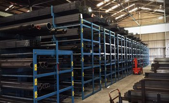 Battery of Cantilever SpaceSaver Racks Storing Various Types of Steel Tubing