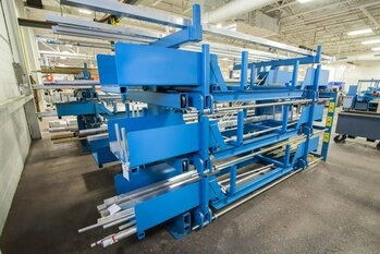 SpaceSaver Roll-Out Cantilever Rack with Auxiliary Supports for Storing Short or Limber Material