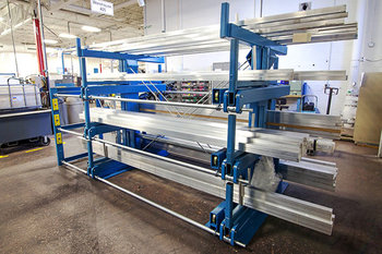 Side-View of a SpaceSaver Cantilever Rack with Three Roll-Out Receptacles and a Fixed Fourth Storage Level