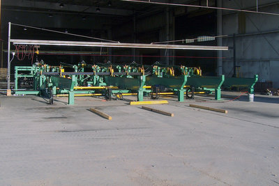 Automated Packaging System for sprinkler pipe mill. System ejects 20' - 40' pipe off the mill exit, accumulates, bundles, transfers to a banding station, and loads packaged bundles of pipe onto a staging transfers.