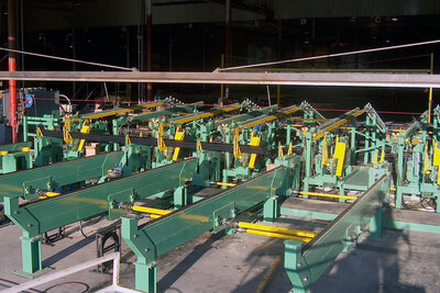 Tube Bundler on an automated mill Packaging System. A hex bundle of tubing is built to a programmed configuration.
