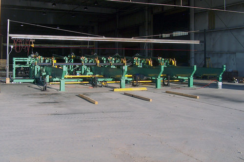 Automated Packaging System for sprinkler pipe mill. System ejects 20' - 40' pipe off the mill exit, accumulates, bundles, transfers to a banding station, and loads packaged bundles of pipe.