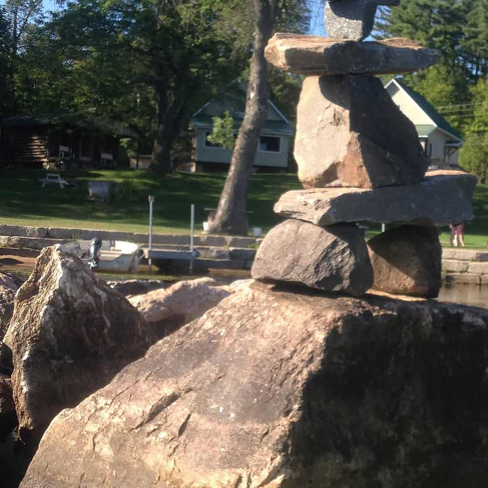 Small Inukshuk on a large rock