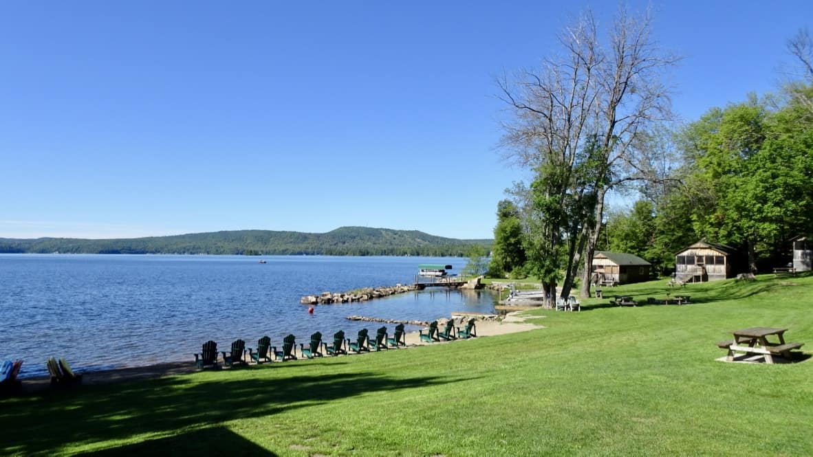 Adirondack chairs along the waterfront at Jocko's Beach Resort & Motel