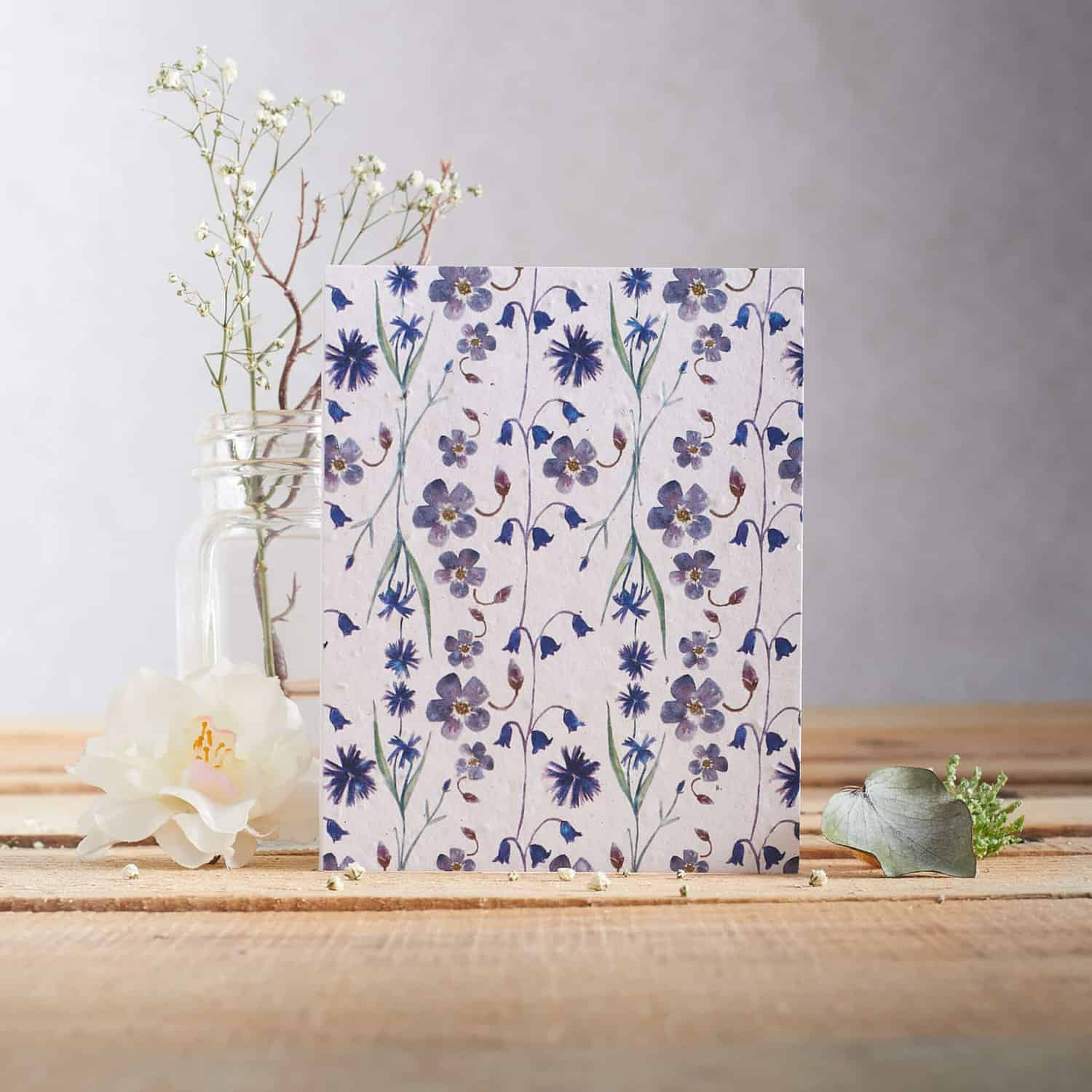 Hannah Marchant illustrates greetings card photographed in rustic setting with shallow depth of field