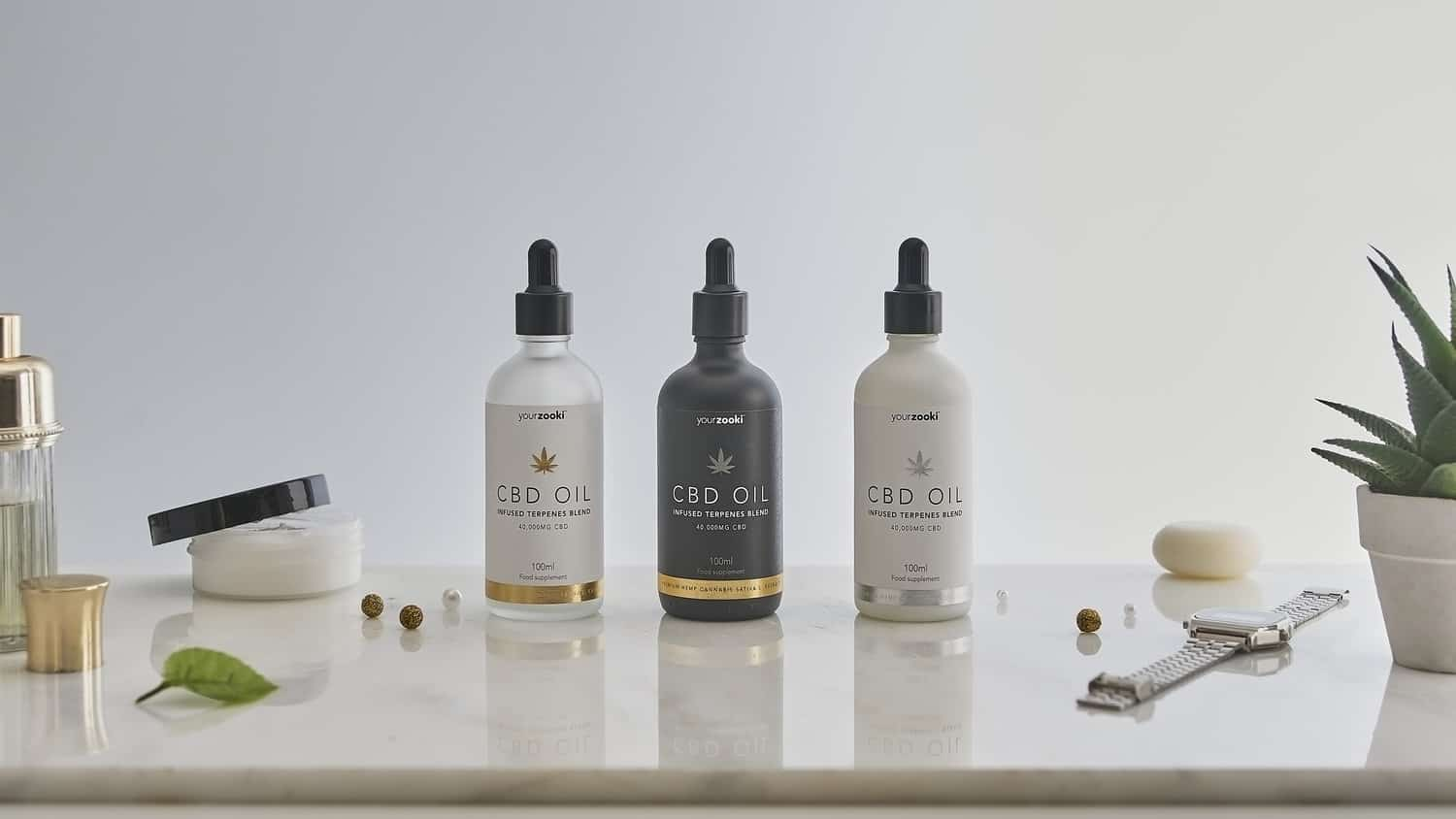 Group product photograph of apothecary bottles in lifestyle minimal setting
