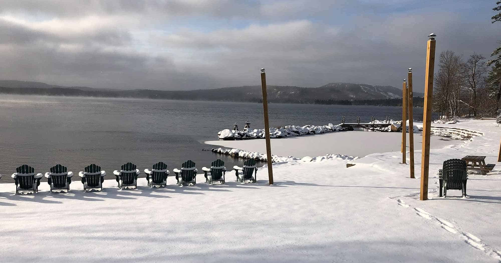 View of the beach in winter, Jocko's Beach Resort and Motel. Dickson Mountain in the background.