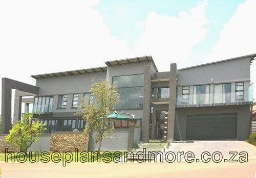 Double storey flat roof house plan design