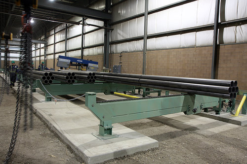 Transfer Conveyor System for Long Bundles of Round Steel Tubing