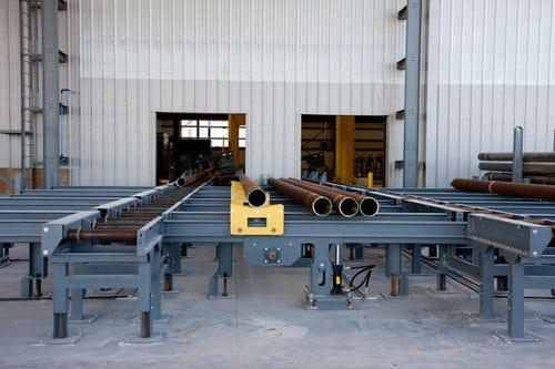 Roller Conveyor with Lift-and-Carry Transfers for Handling Round Steel Tube